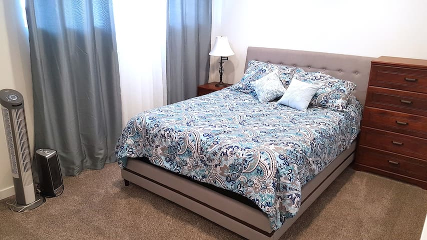 Carpeted bedroom with  comfy bed and double closet