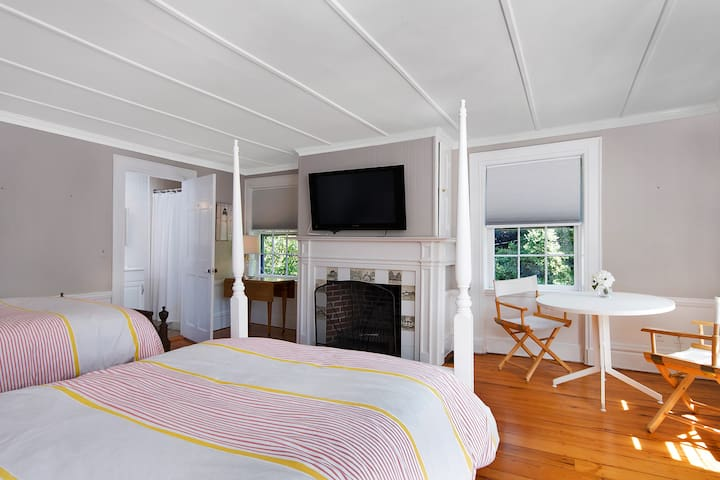 Upstairs Guest room #2 with two double beds, TV and ensuite full bath