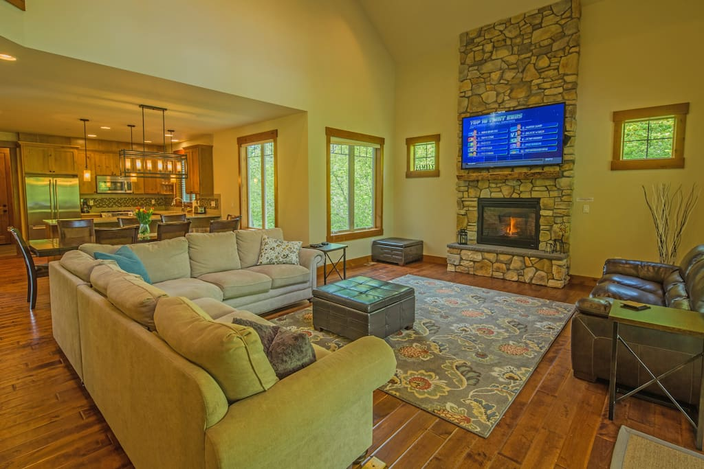 Fantastic great room with vaulted ceiling and a floor to ceiling ledgestone gas fireplace!