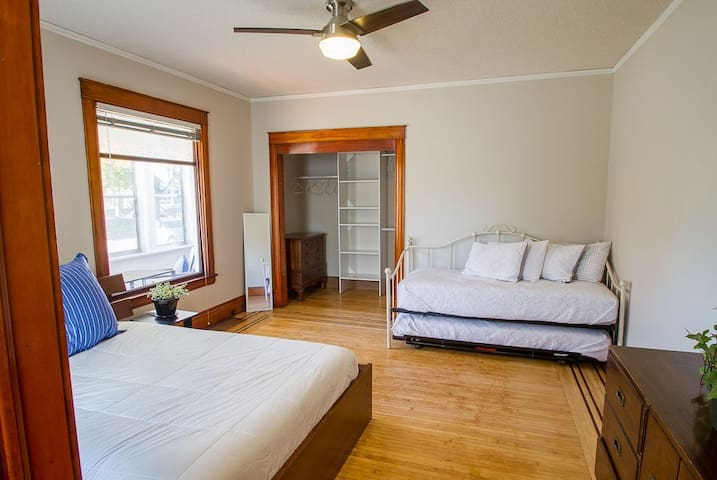 Front bedroom with a queen bed and two twin beds