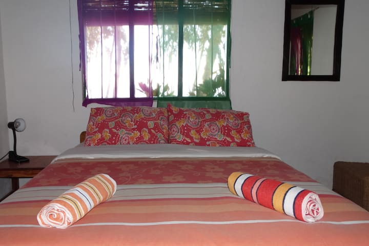 Comfortable double bed in front bedroom.