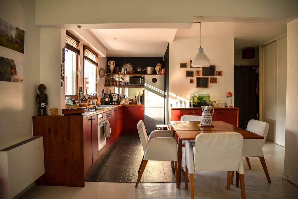 a sunny kitchen nearby the main entrance