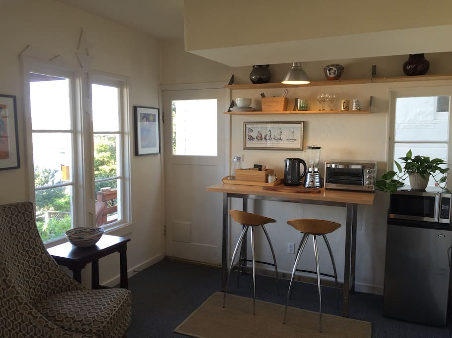 Kitchenette in lounge area includes refrigerator, large toaster oven, electric kettle and microwave.