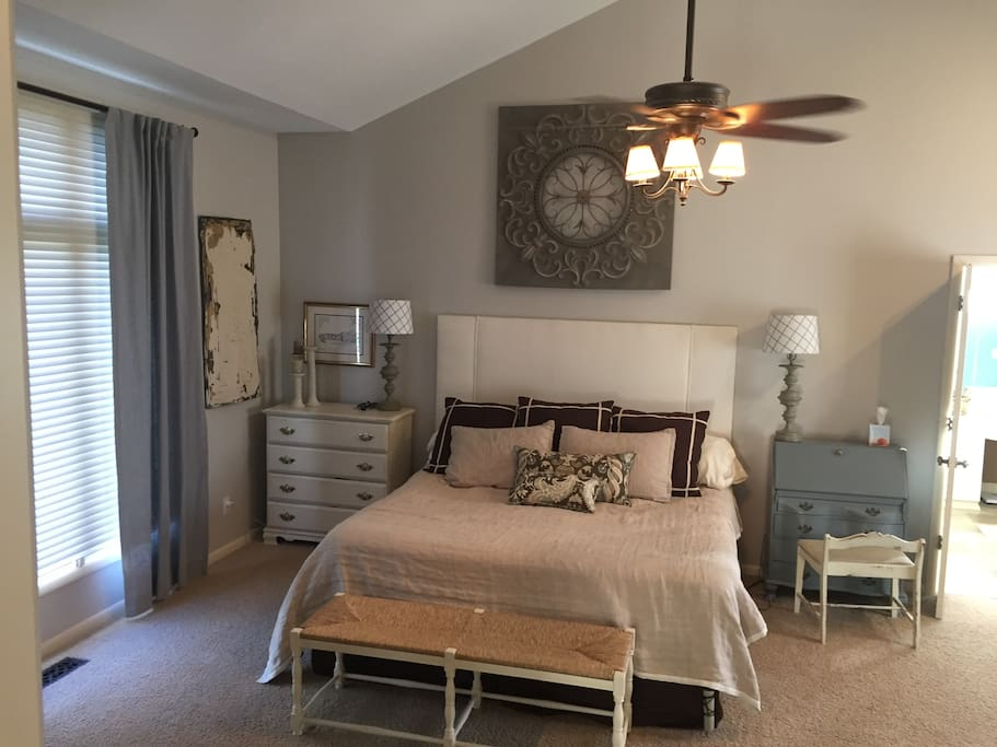 Master Bedroom with King Size Bed and walk out to patio.