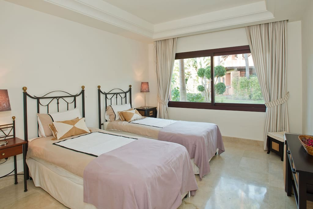 Bright and spacious bedroom with two comfortable single beds