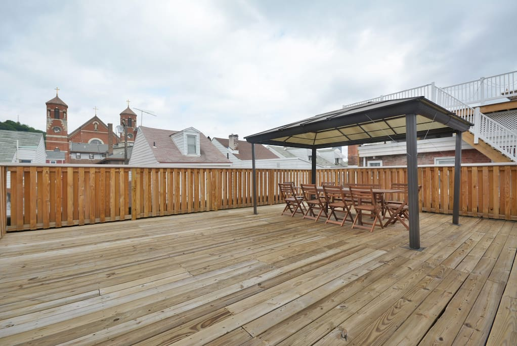 Our roof deck offers scenic views of Pittsburgh and the perfect gathering space for your group!