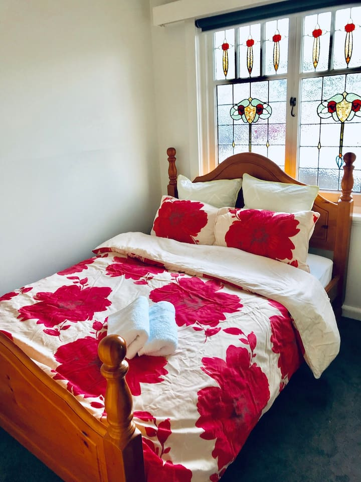 Comfortable double bed in a sunny and quiet bedroom.