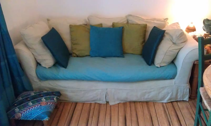 Comfortable sofa.  Garden, and wide screen TV with Freesat all in a shared area.
