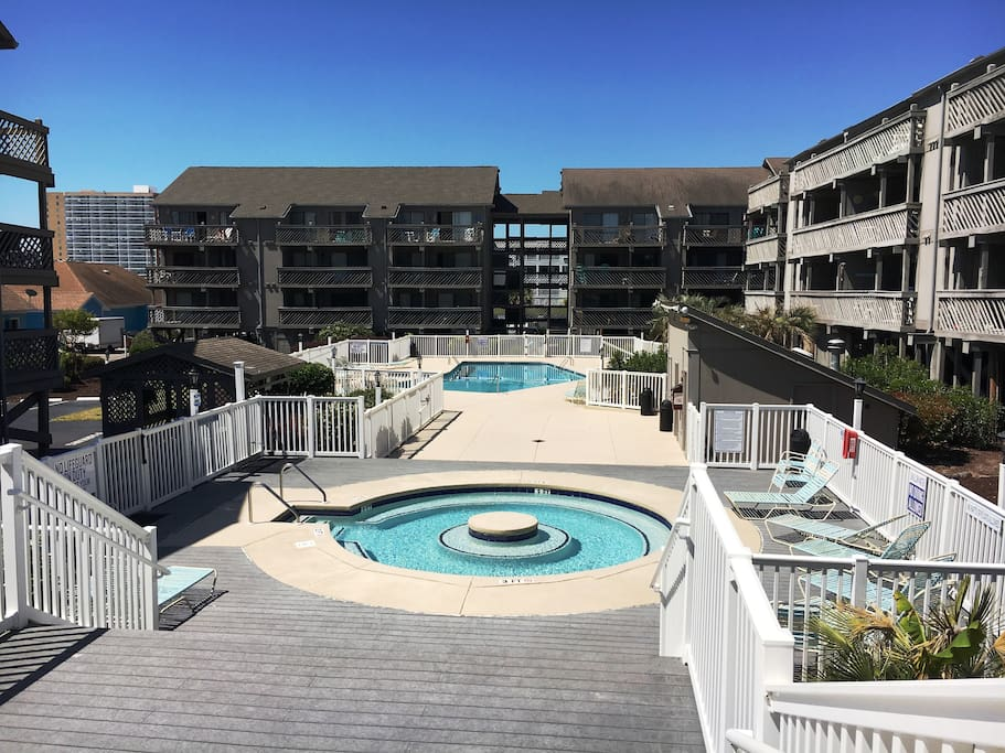 Hot Tub- and several outdoor pools only steps from the condo
