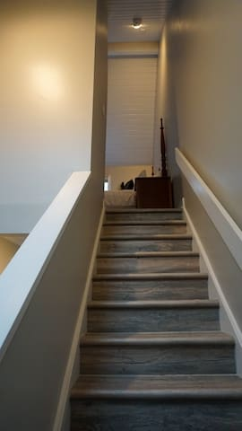 Stairs to the master bedroom and bath