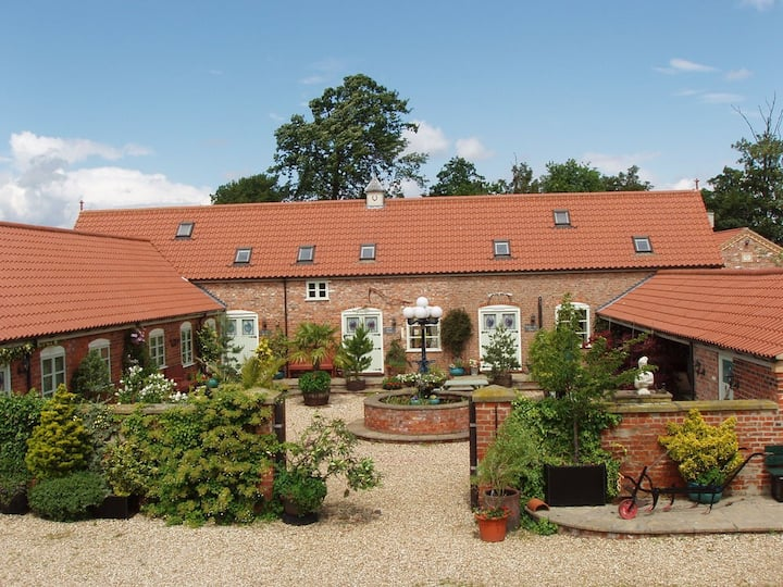 8 Country cottages in a beautiful green location.