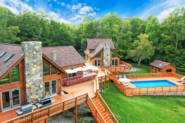 Estate has a main house, guest house, pool, hot tub, and sauna (small building behind the pool)! Plenty of privacy as the home is surrounded by woods on three sides, with the fourth side being the backyard.