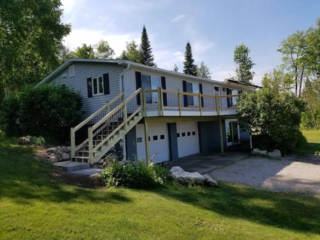 Cottage - Lower Level covered entry. Upper staircase to deck.