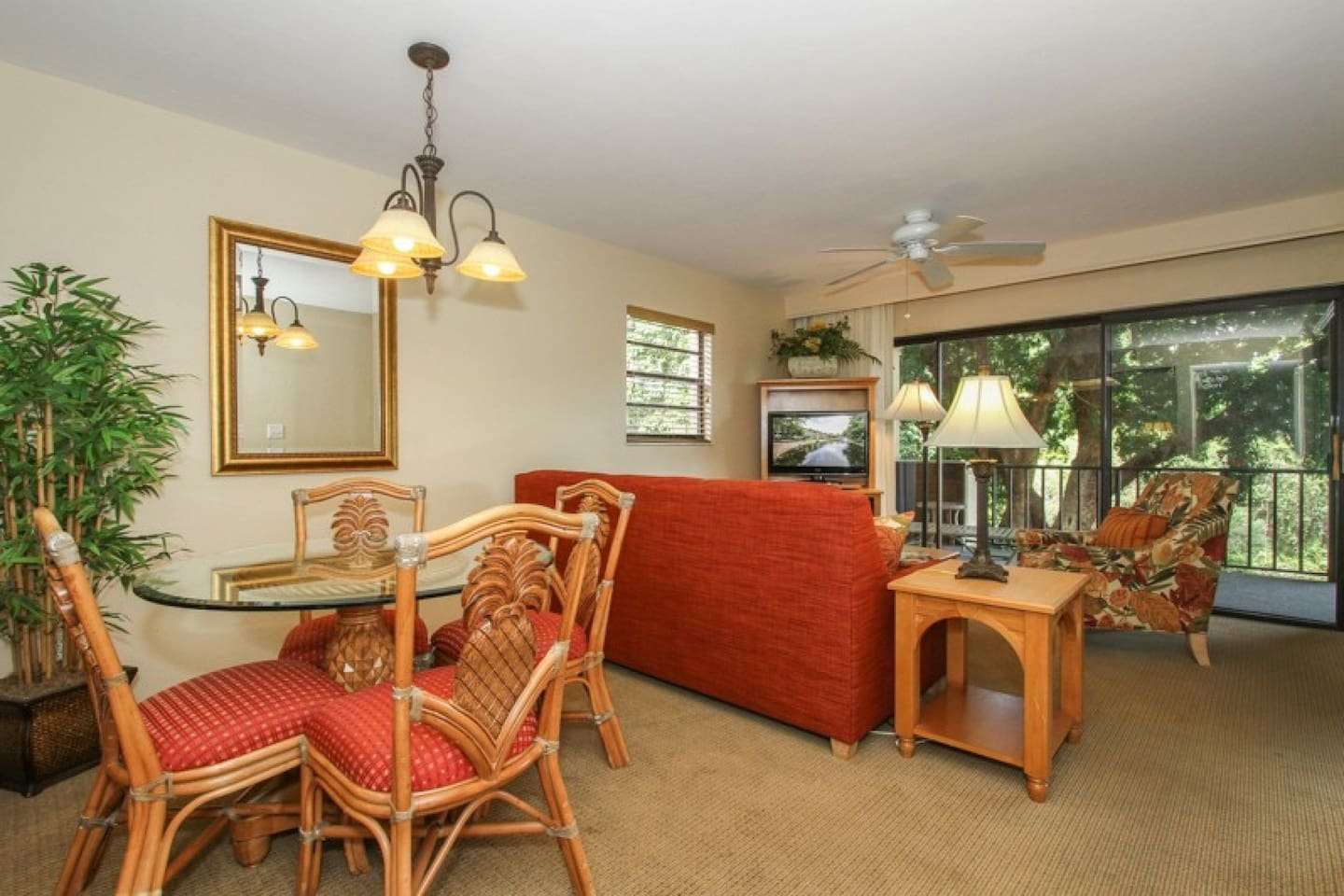 Professionally decorated living room/dining room w/glass sliding doors to balcony w/lake view