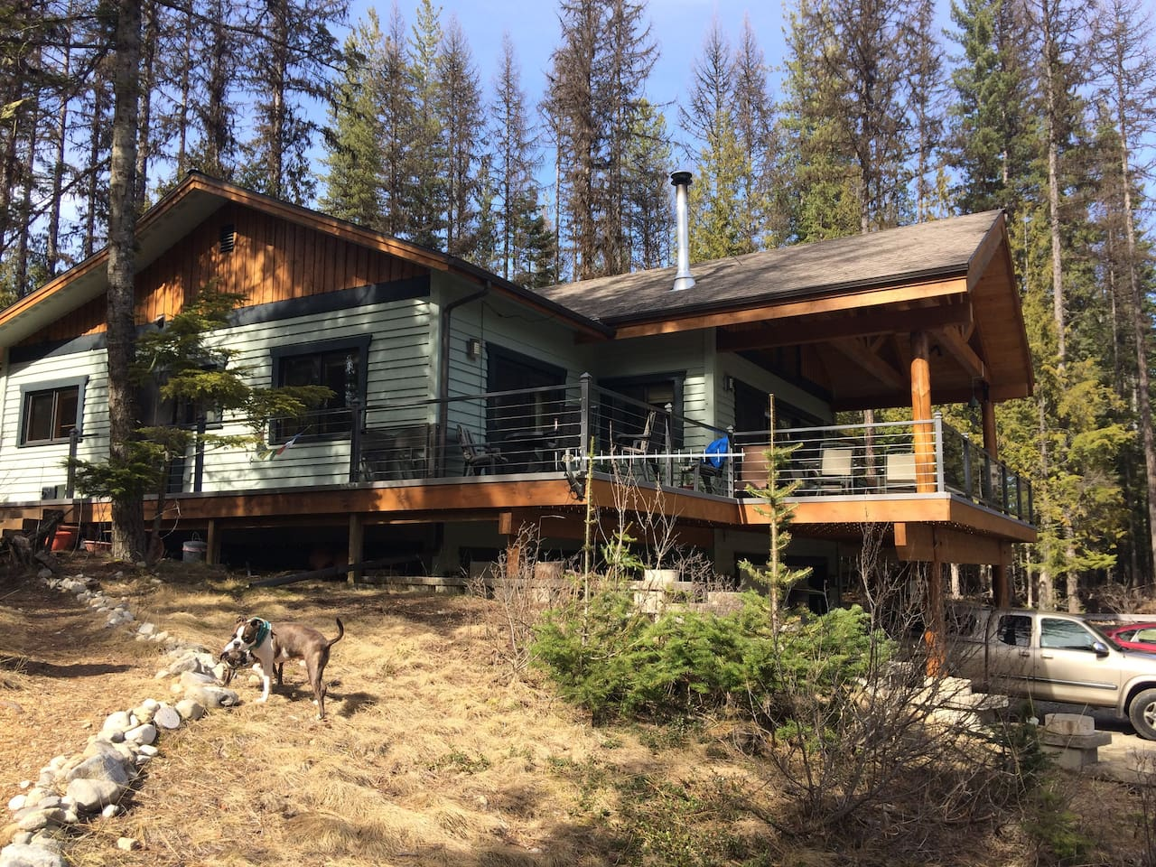 This is our home overlooking Priest lake, with your bedroom slider door opening onto the deck.
