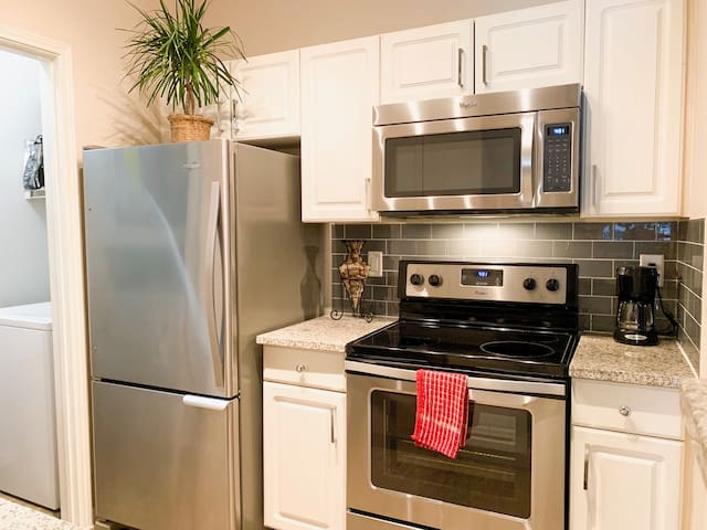 Kitchen - Fully upgraded with new appliances, granite counter tops, Refrigerator/Freezer, Dishwasher, Microwave, Stove, Oven, Coffee & ample cabinet space with full set of dishes & cooking supplies. Includes hand & dish soap & all cleaning supplies.