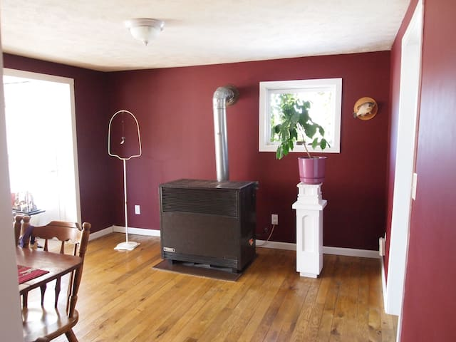 Dining room is adjoined to the living room but feels like it own separate space. Don't fear over the heater, it will be off in the warm months! Diner room table sits six comfortably.