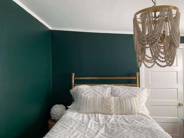 A comfy antique bed.
