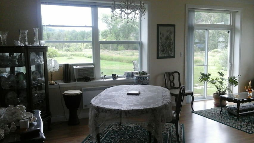 dining area, and grounds leading into Gatineau Park