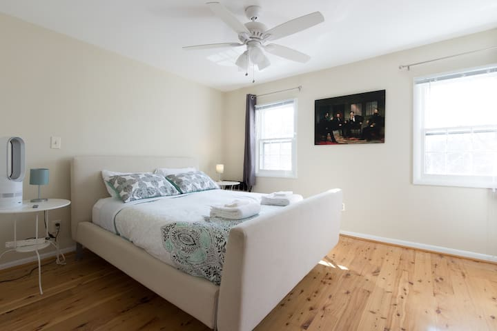 """The spacious """"Lincoln Bedroom"""" features an upholstered queen bed, a dresser and double-closets."""