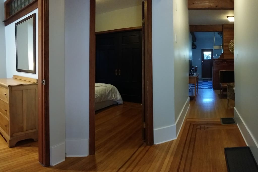 View from entry door.  Bedrooms on left with hallway through living room leading to kitchen, back bedroom and bathroom.