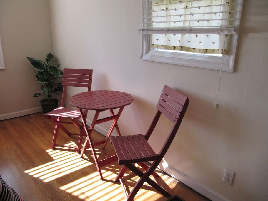 Bistro table with chairs for snacking in your room.