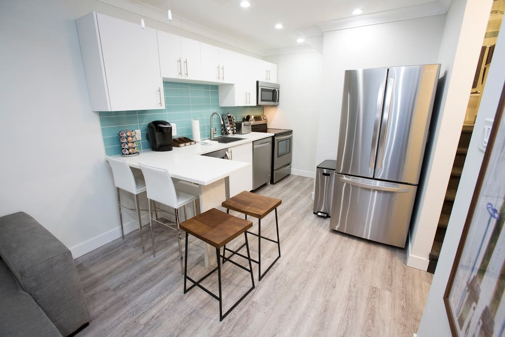 Kitchen with full size appliances and wine fridge!