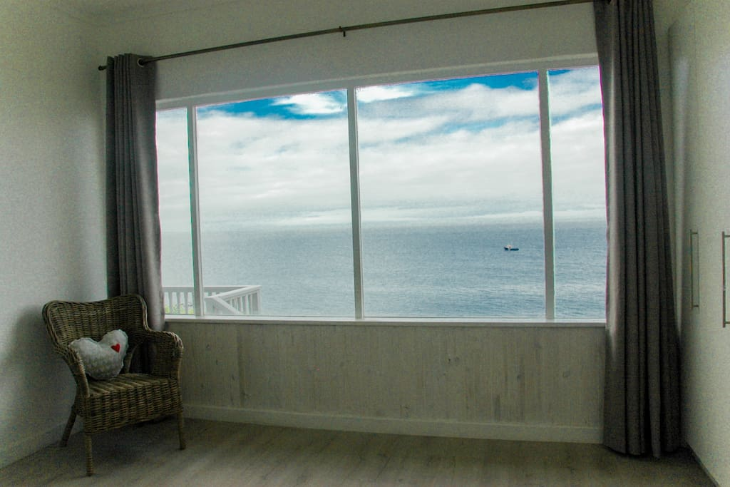 sea and cloud view from your bed - watch the whales from your bed if you are lucky!