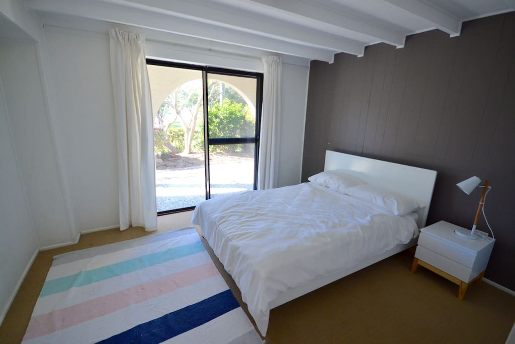 Main bedroom with double bed and ocean views