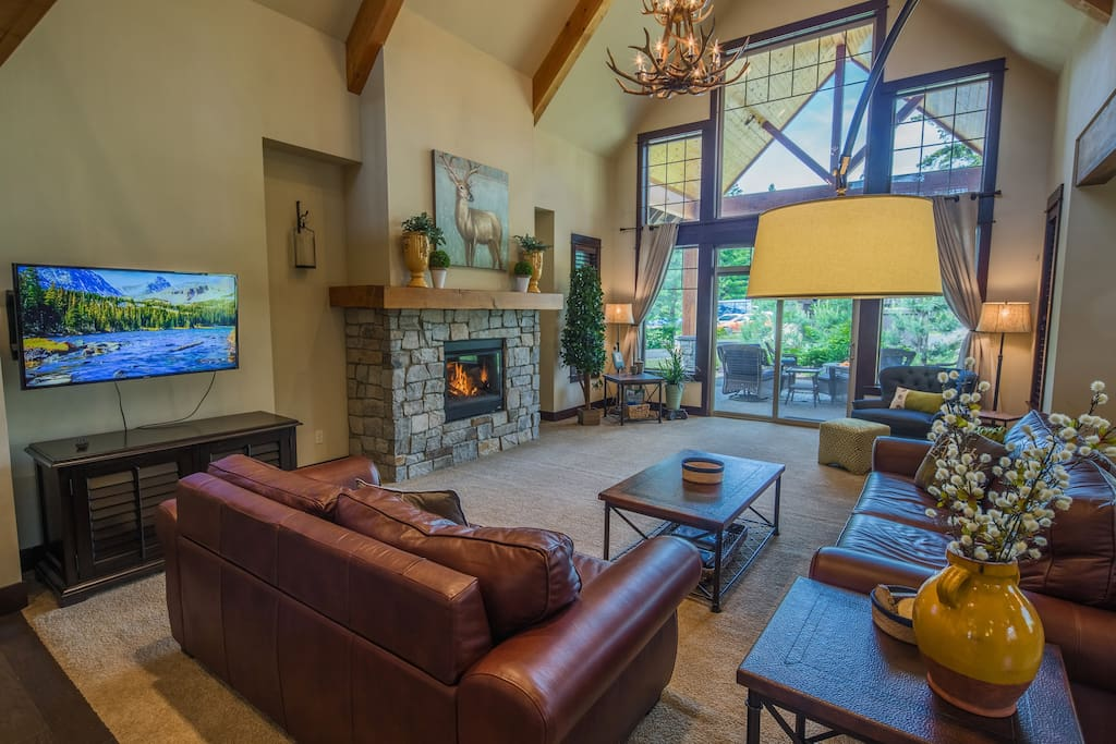 Fabulous great room with a gas fireplace and large TV.