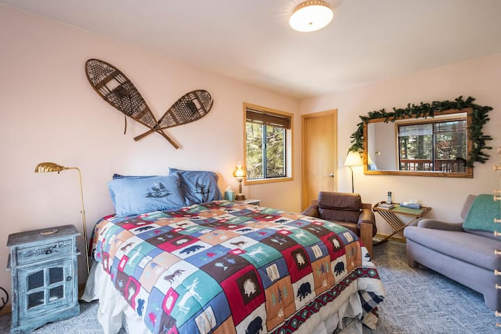 Upstairs bedroom with full bed and deck