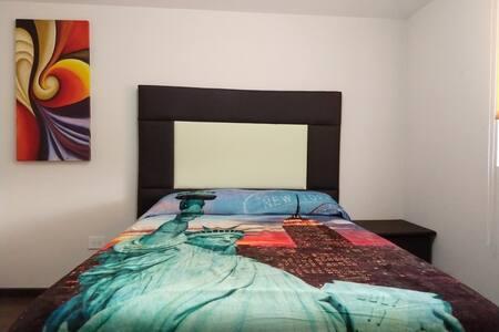 Linda Habitación minimalista, céntrica y segura.
