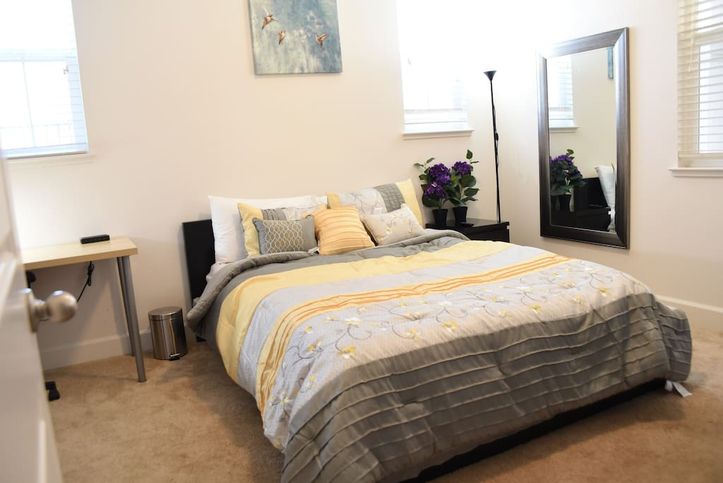 Bedroom with queen bed, working space and private bathroom