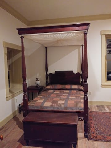 Sheraton room with bed , chest of drawers, blanket chest and postman desk.