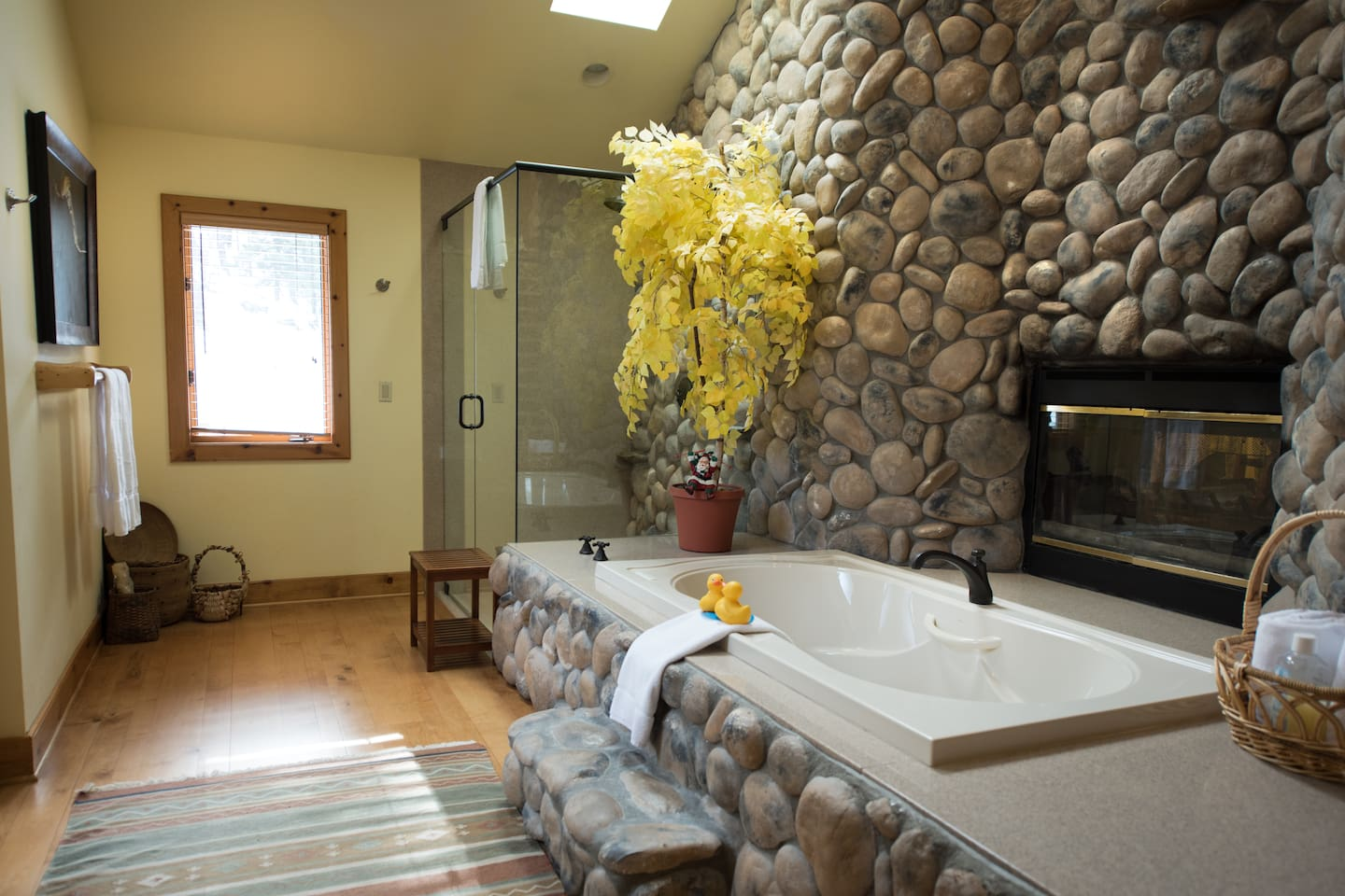 Rock wall shower; large tub for 2; and a see-through fireplace.
