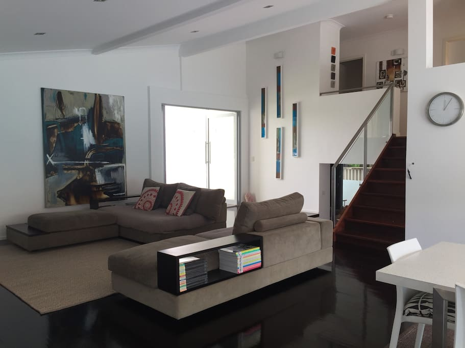 Main living space is nice and open with cool breezes from the Nerang river across the road.