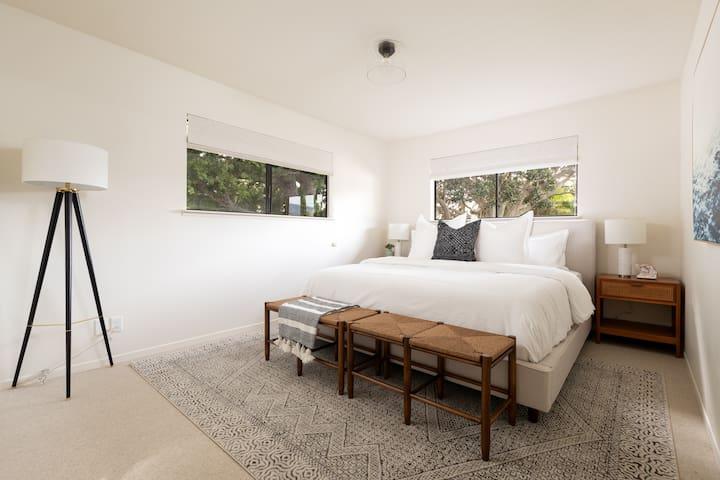 The second bedroom has a King sized Casper Mattress & Parachute Linens