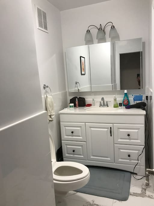 Well-lit and recently renovated bathroom.
