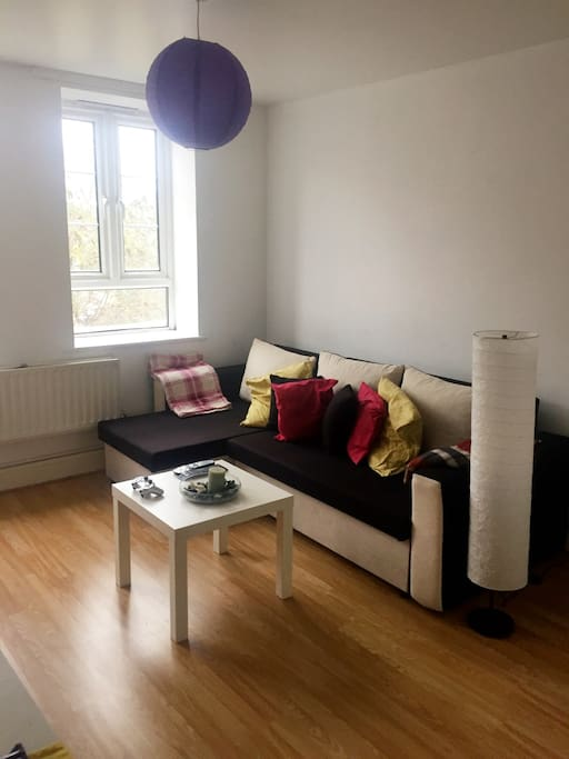Spacious living room with sofa bed, big flat screen tv, PlayStation 3,Netflix, 1 small table, 1 big table with 3 chairs