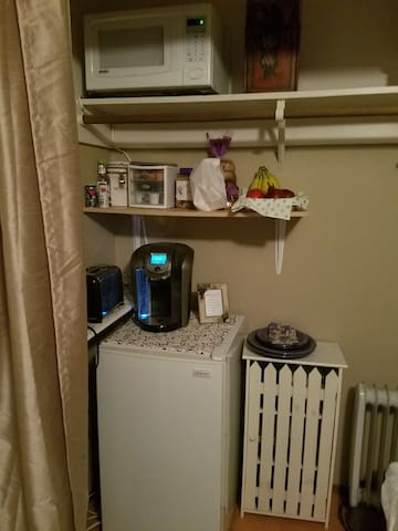 Little kitchette, Kurig coffee maker, toaster, microwave, plates, utincils.