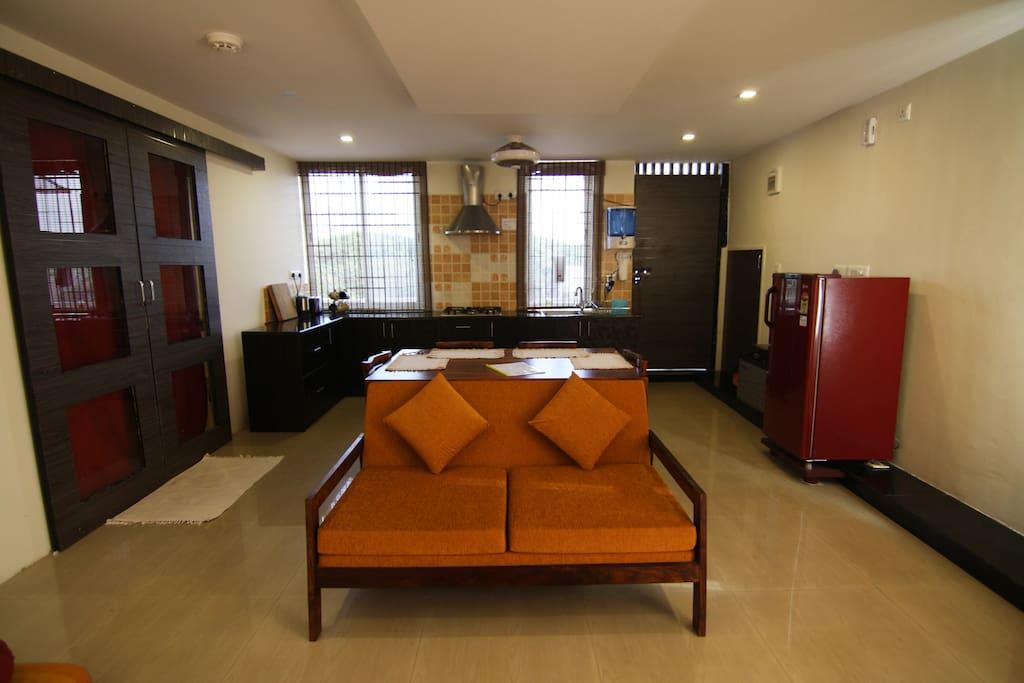 Living room with closed door to bedroom