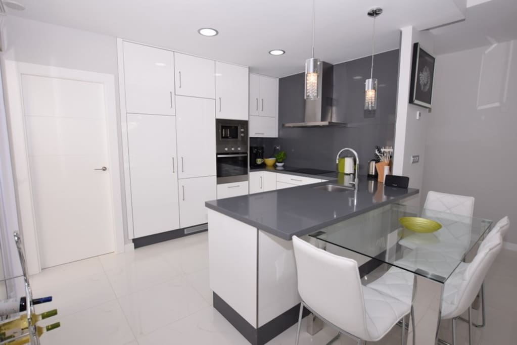 Fully equipped kitchen including oven/hob/microwave/dishwasher/washing machine