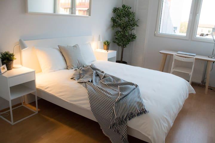 Calm, clean, comfortable bedroom.  Pure serenity.