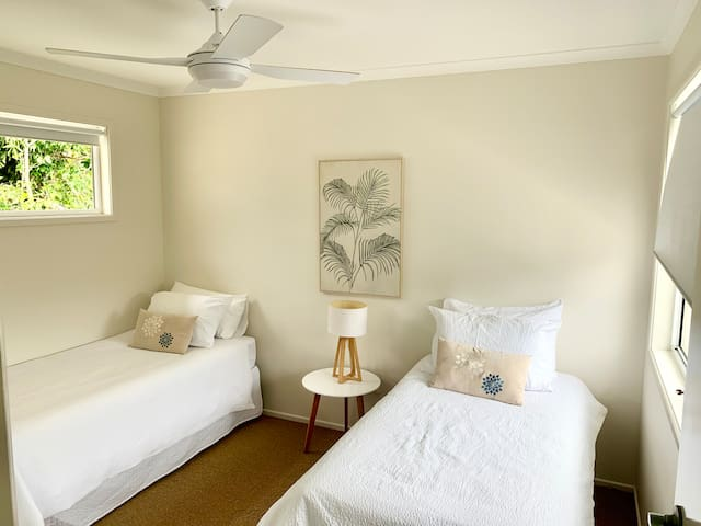 One of the bedrooms. It features 2 single beds and ideal for families with kids.