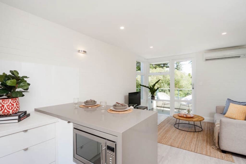 fully equipped kitchen with cute breakfast bar