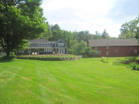 House, large barn and yard with pond on right