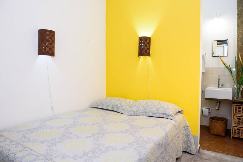Comfortable bedroom with double bed, ceiling fan, split system aircon, private ensuite bathroom, large wardrobe, full-length mirror, new pillows, 300-threadcount bedsheets, blankets, towels.