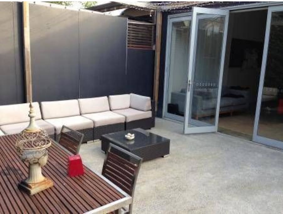 Living area opens to nice back patio with BBQ