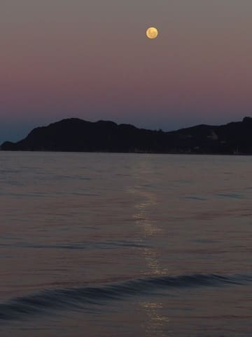 Full moon at sunset at our local beach within walking distance