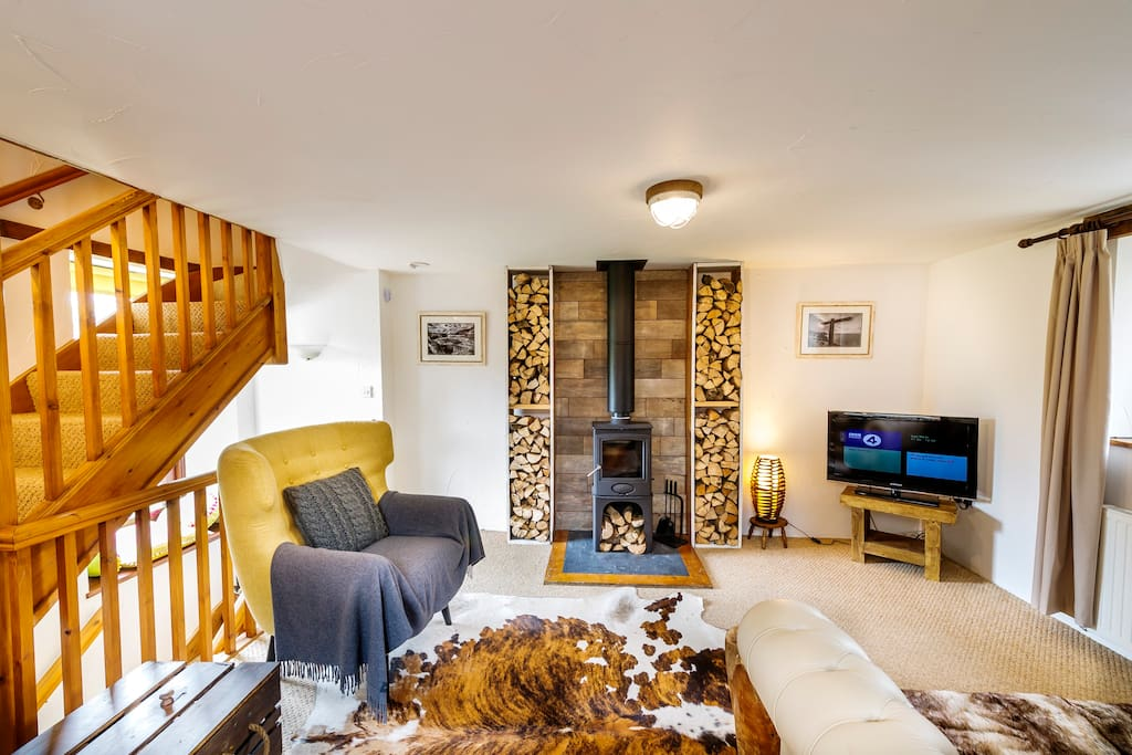 Open plan lounge with cosy wood burner